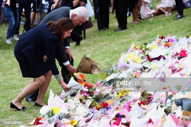 Premier Annastacia Palaszczuk and MP Joe Kelly lays flowers during a vigil to remember murdered mother Hannah Clarke and her three children at Bill...