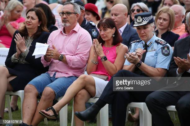 Premier Annastacia Palaszczuk Lloyd and Suzanne Clarke parents to Hannah Clarke and Police commissioner Katarina Carroll attend a vigil to remember...