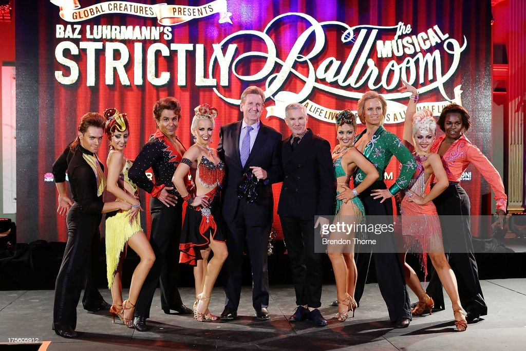 NSW Premier, Barry O'Farrell and Baz Luhrmann (C) pose with dancers at the 'Strictly Ballroom The Musical' media call at Sydney Town Hall on August 5, 2013 in Sydney, Australia.