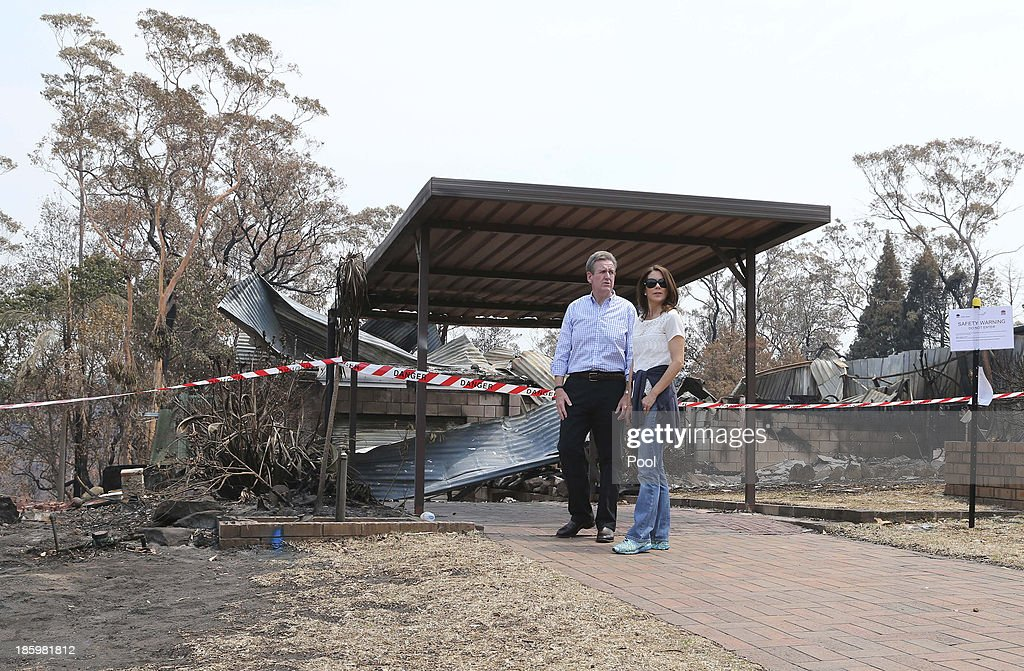 Premier Barry O'Farrell and Princess Mary of Denmark walk through one of the many streets of bush fire devastation on October 27, 2013 in Winmalee, Australia. Prince Frederik and Princess Mary will visit Sydney for five days and will attend events to celebrate the 40th anniversary of the Sydney Opera House and the Danish architect who designed the landmark, Jorn Utzen.