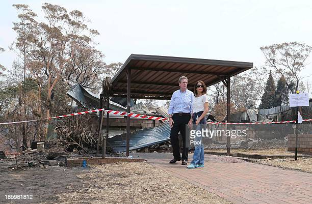 Premier Barry O'Farrell and Princess Mary of Denmark walk through one of the many streets of bush fire devastation on October 27 2013 in Winmalee...