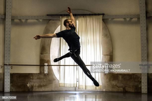 Premier Danseur of the Paris Ballet Opera Francois Alu rehearses during a photo session at the Opera Garnier in Paris on June 21 2018