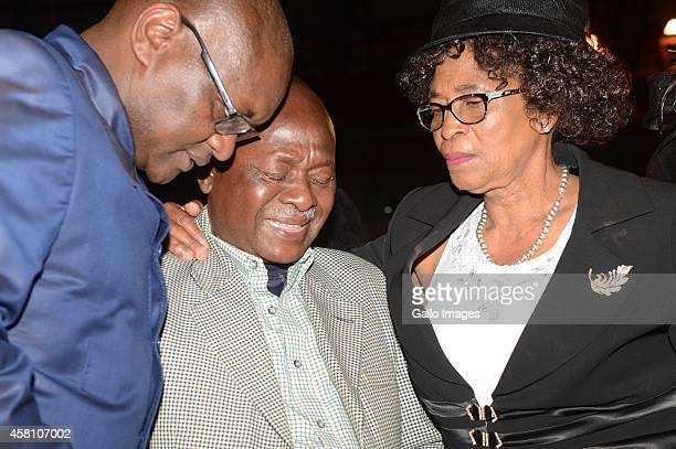 Premier David Makhura and MEC of Sport Molebatsi Bopape comfort Senzo's father Samuel Meyiwa during the joint Memorial Service of the three late...