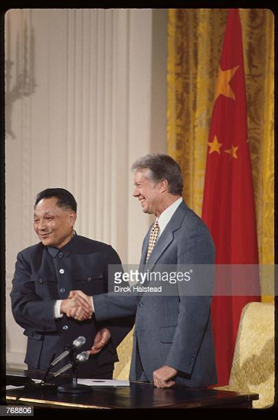 Premier Deng Xiaoping and President Jimmy Carter shake hands January 31 1979 in Washington DC Xiaoping and President Carter met in Washington DC and...