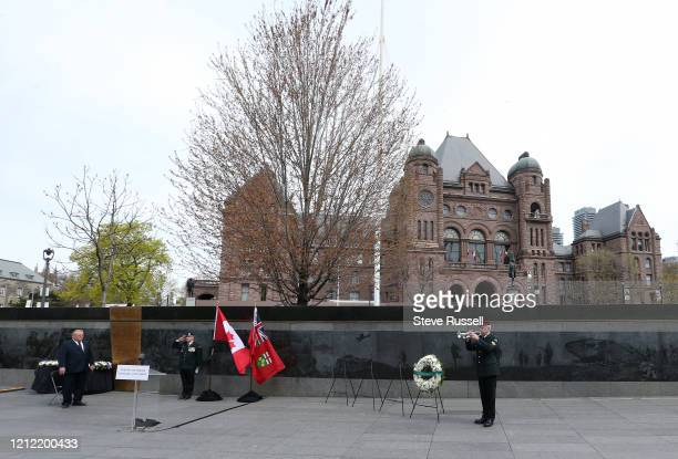 Premier Doug Ford attends wreath-laying ceremony to mark the 75th anniversary of Victory in Europe Day at the Ontario Veterans' Memorial South lawn...