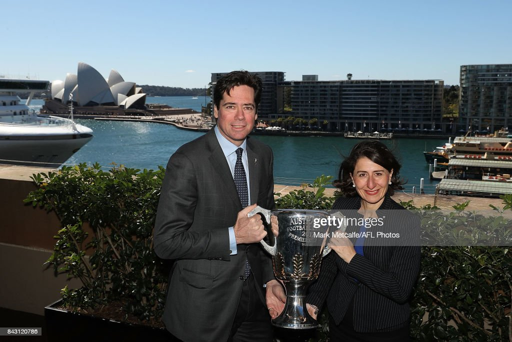 Premier Gladys Berejiklian and AFL CEO Gillon McLachlan pose with the AFL trophy during the AFL Grand Final media announcement at The Museum of Contemporary Art Australia on September 6, 2017 in Sydney, Australia.