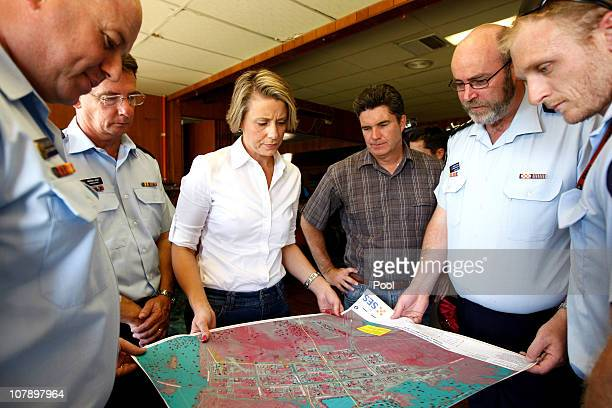 Premier Kristina Keneally and Emergency services minister Steve Whan talk to the SES about their flood plan on January 6 2011 in Goodooga New South...