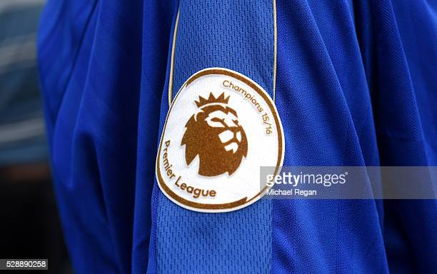 Premier League Champions badge adorns a fan's shirt outside the stadium before the Barclays Premier League match between Leicester City and Everton...