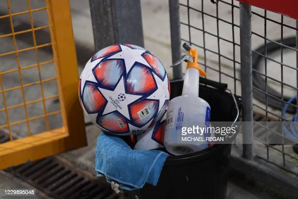 Premier League football is seen alongside sanitiser during the UEFA Champions League 1st round Group D football match between Liverpool and Ajax at...