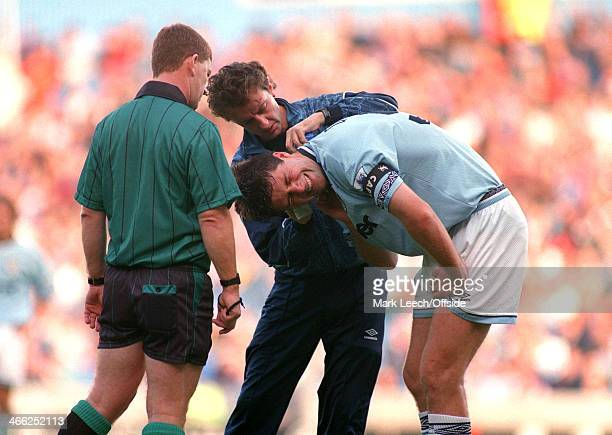 Premier League Football Manchester City v Nottingham Forest Niall Quinn of City receives treatment from the physiotherapist for a neck injury