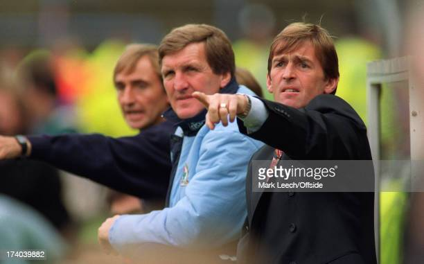 Premier League football Wimbledon v Blackburn Rovers Rovers manager Kenny Dalglish points as he sits in the dugout with Ray Harford and Tony Parkes