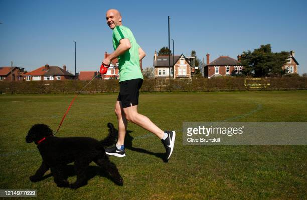 Premier League referee Anthony Taylor trains with his dog Monty during the lockdown caused by the coronavirus pandemic on March 26 2020 in Manchester...