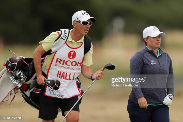 Premier League referee Mike Dean caddying for Lydia Hall of Wales during day three of Ricoh Women's British Open at Royal Lytham St Annes on August 4...