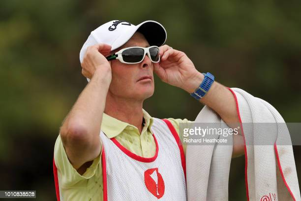 Premier League referee Mike Dean looks on while caddying for Lydia Hall of Wales during day three of Ricoh Women's British Open at Royal Lytham St...