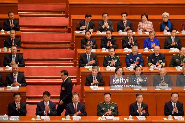 Premier Li Keqiang passes by delegates before his report during the opening session of the National People's Congress at The Great Hall of People on...