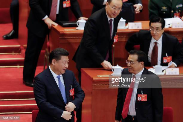 Premier Li Keqiang talk with Chinese President Xi Jinping after the opening session of the National People's Congress at The Great Hall of People on...