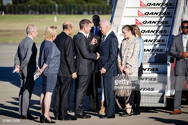 Premier Mike Baird greets US VicePresident Joe Biden and his granddaughters at Sydney Airport on July 18 2016 in Sydney Australia Biden is visiting...