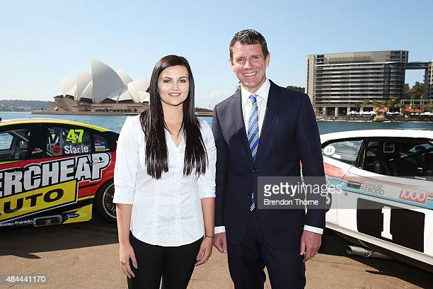 Premier Mike Baird poses with V8 Supercar driver Renee Gracie during a V8 Supercars media announcement about the Bathurst 1000 at Overseas Passenger...