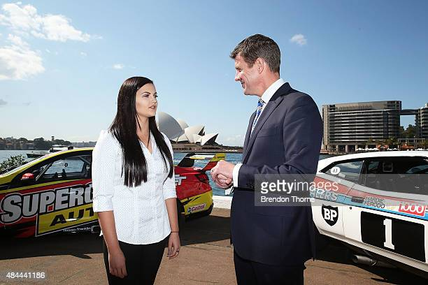 Premier Mike Baird speaks with V8 Supercar driver Renee Gracie during a V8 Supercars media announcement about the Bathurst 1000 at Overseas Passenger...