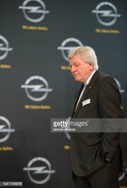 Premier of Hesse Volker Bouffier stands in front of a wall with Opel logos at AdamOpelHaus in Ruesselsheim Germany 10 April 2013 The board of...
