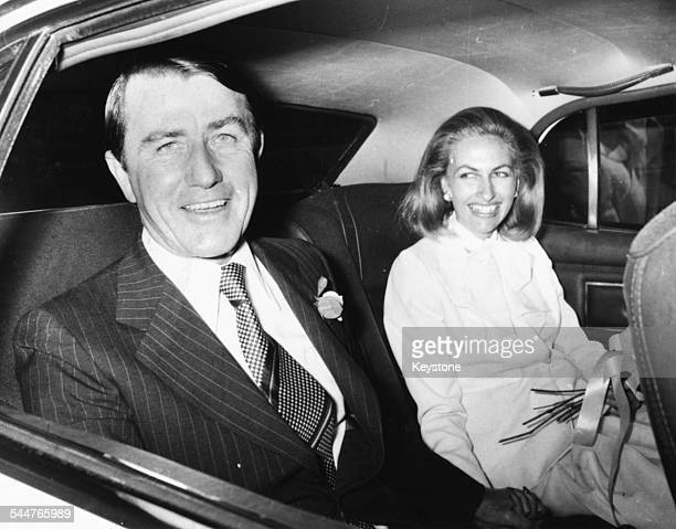 Premier of New South Wales Neviile Wran with his new wife Jill Hickson in the back of a car following their quiet garden wedding Sydney August 1976