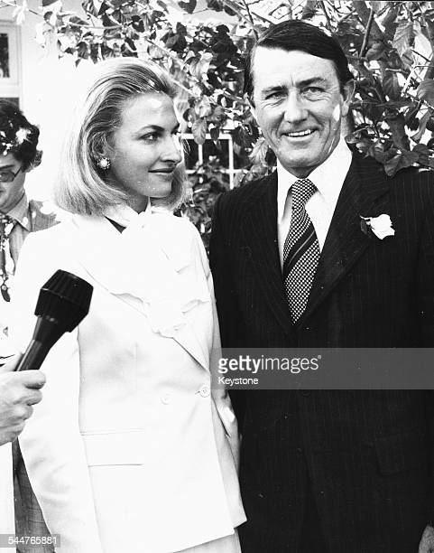 Premier of New South Wales Neviile Wran with his new wife Jill Hickson talking to the press following their quiet garden wedding Sydney August 1976