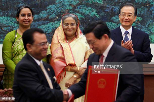 Premier of the People's Republic of Bangladesh Ms Sheikh Hasina and Chinese Premier Wen Jiabao attend a signing ceremony in the Great Hall of the...