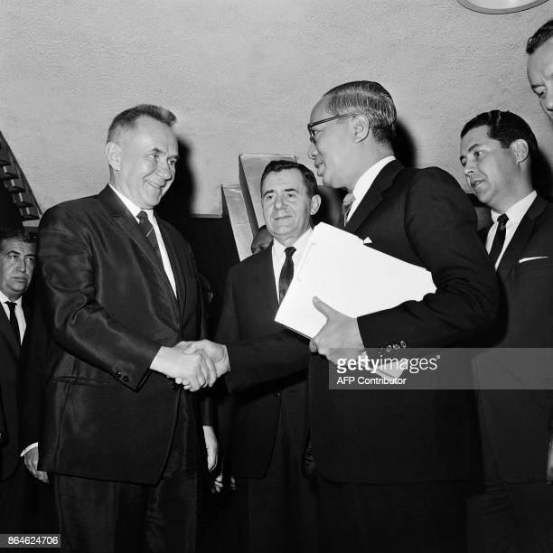 Premier of the Soviet Union Alexei Kosygin shakes hands to UN General secretary U Thant as Russian Minister of Foreign Affairs Andrei Gromyko looks...