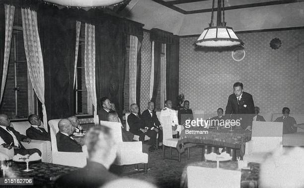 Premier Prince Fumimaro Konoye President of the House of Peers right is shown here at table as he discussed with the newly assembled Japanese cabinet...