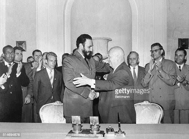 Premiers Nikita Khrushchev of the Soviet Union and Fidel Castro of Cuba shake hands and start to embrace in Moscow. Castro made a state visit to the...