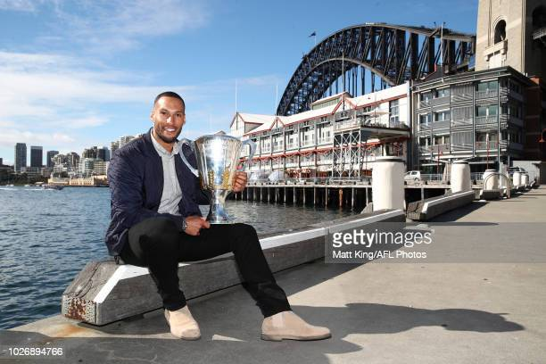 Premiership Cup Ambassador Josh Gibson poses with the AFL Premiership Cup during the 2018 Toyota AFL Finals Series in Sydney Media Event at View by...