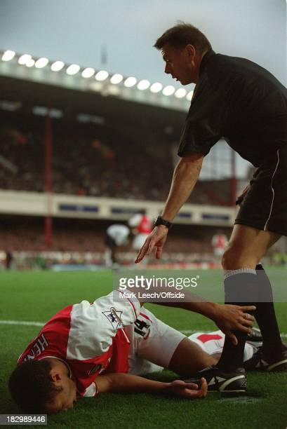 Premiership Football - Arsenal v Tottenham Hotspur, Referee Halsey stops play as he attends to Thierry Henry who had sustained a serious looking...