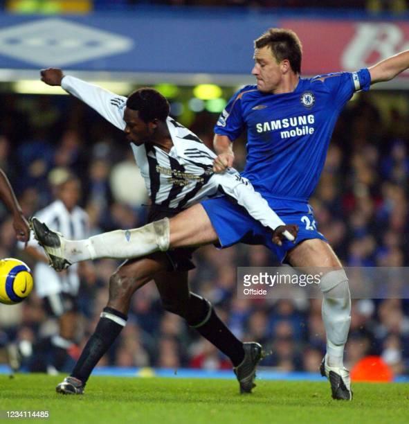 Premiership Football, Chelsea v Newcastle United, John Terry of Chelsea sticks in a foot to tackle Shola Ameobi of Newcastle.
