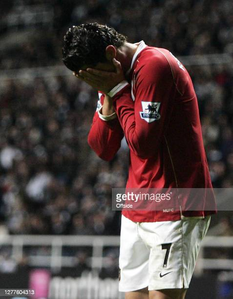 "Premiership Football - Newcastle United v Manchester United.""nManchester Utd Cristiano Ronaldo covers his face after a missed chance on goal against..."