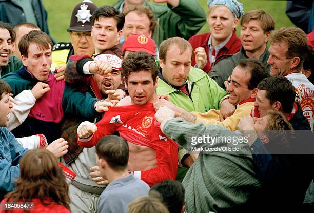 Premiership Football- Wimbledon v Manchester United, Eric Cantona is mobbed by United fans as they celebrate their league victory.