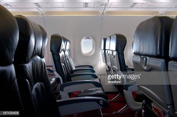 Premium Economy Class Seating Inside An Airplane Cabin