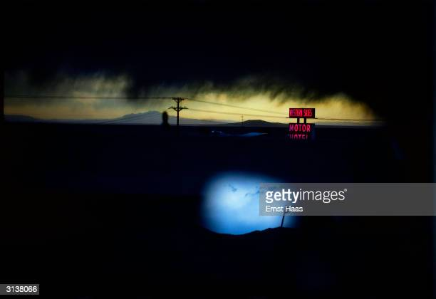 A cloudy night sky over the Western Skies Motor Motel in Colorado Colour Photography book