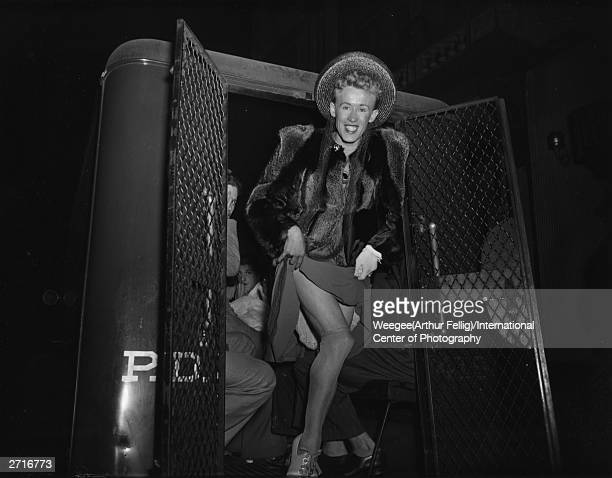 Premium Rates Apply A man is arrested for crossdressing and makes a final spectacle of himself before being taken away in a police van Photo by...