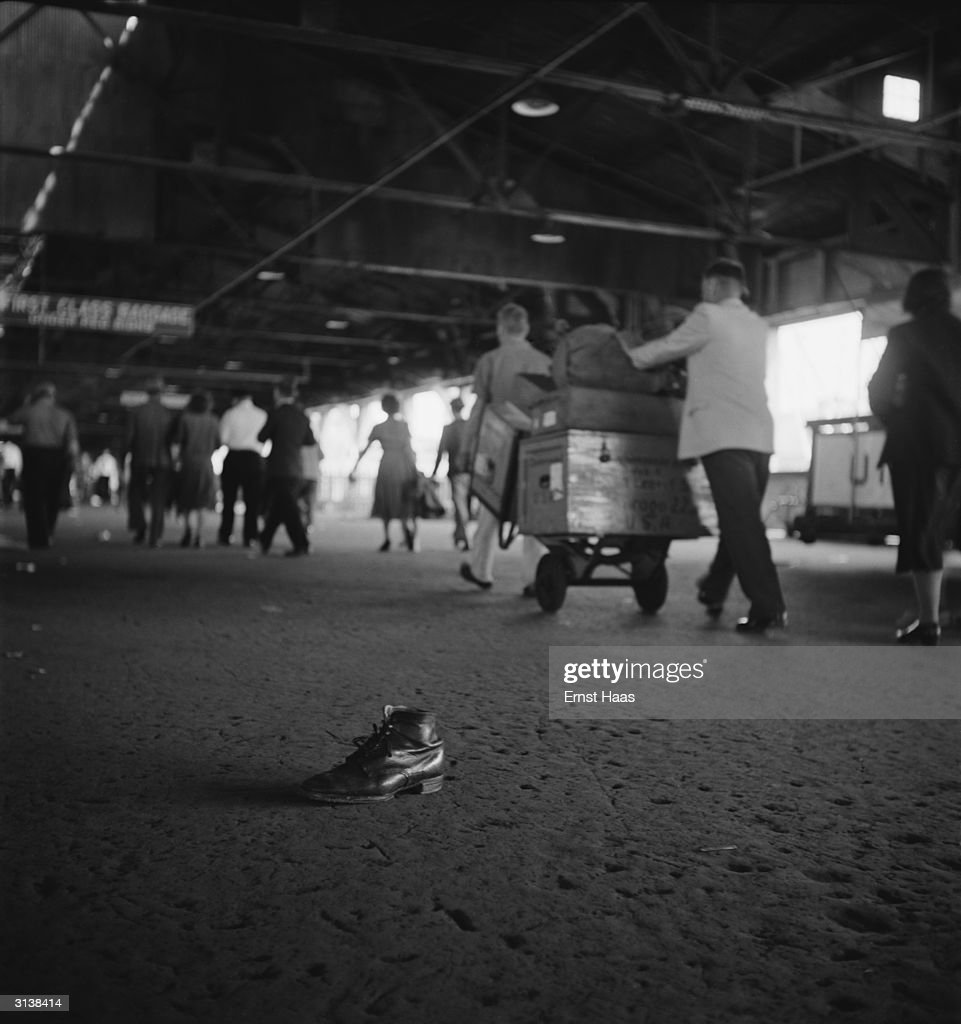 A solitary boot at Ellis Island left behind as passengers on the last boatload of displaced persons from Europe make their way to a new life.