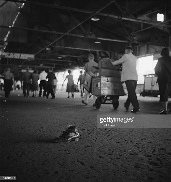 Premium Rates Apply A solitary boot at Ellis Island left behind by passengers who have have recently arrived on board the USS General R M Blatchford...
