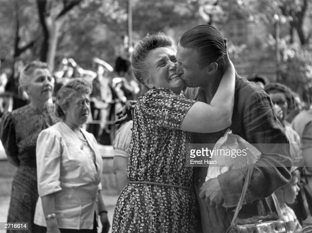 Premium Rates Apply A woman greets her son an Austrian prisoner of war returning home to Vienna Original Publication In black and white book