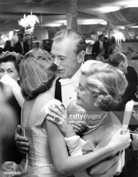 Premium Rates Apply American actor Gary Cooper with his wife Veronica Balfe and daughter Maria Cooper at a New Year's party held at Romanoff's in...
