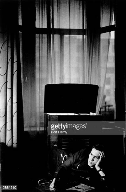 Premium Rates Apply American 'sob singer' Johnnie Ray lying on his bed listening to the radiogram in his suite at London's Savoy Hotel during his...