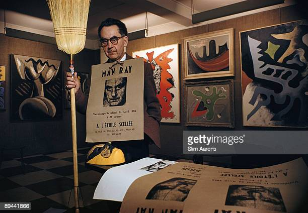 Premium Rates Apply. American surrealist artist and photographer Man Ray with some examples of his work at his Left Bank studio in Paris, April 1956....