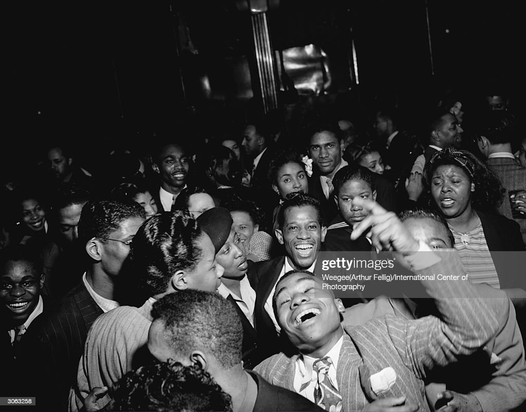 A riotous group of partygoers at a New York venue. (Photo by Weegee(Arthur Fellig)/International Center of Photography/Getty Images)