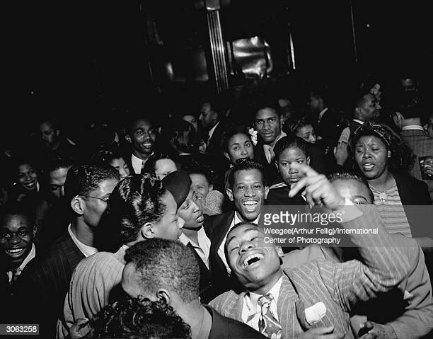 A riotous group of partygoers at a New York venue Photo by Weegee/International Center of Photography/Getty Images