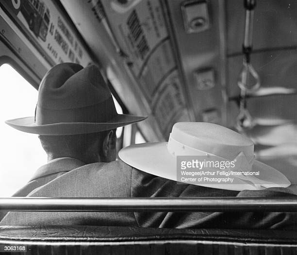 A man puts his arm around his female companion during a bus journey Photo by Weegee/International Center of Photography/Getty Images