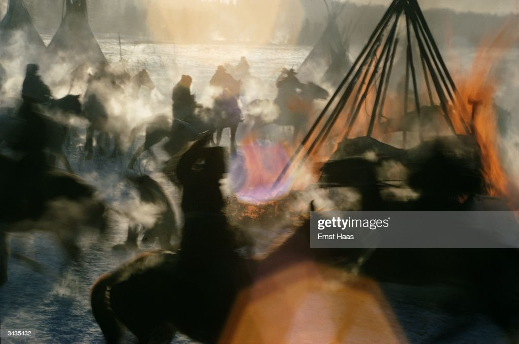 An Indian camp being attacked and tepees burnt in an enactment of a battle scene for the film, 'Little Big Man'.