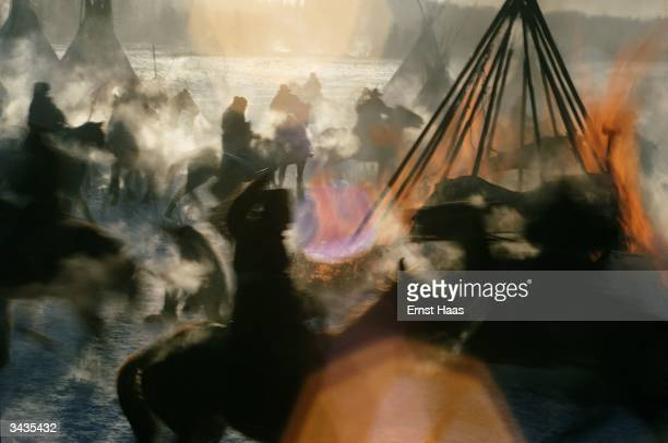An Indian camp being attacked and tepees burnt in an enactment of a battle scene for the film 'Little Big Man'