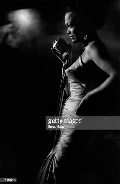 Premium Rates Apply Eartha Kitt sings in New York Original Publication In black and white book